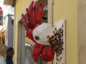 A paper mache rooster outside a lovely art shop.