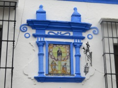 A lovely wall plaque on an equally lovely town square.