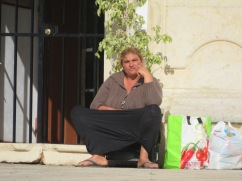In the seven years I have been coming here, this same gypsy woman has been sitting outside the same church begging.