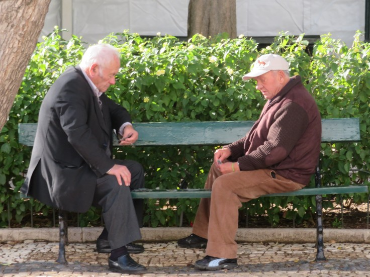 These two old friends were playing checkers.