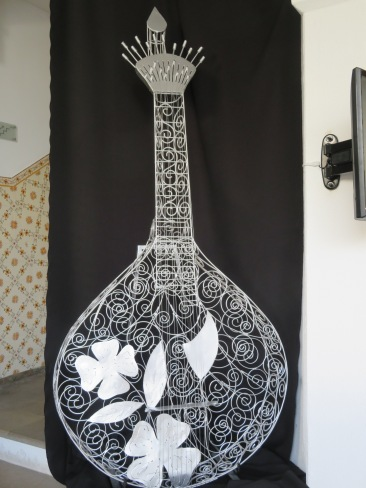 This beautiful sculpture of a Portuguese guitar.