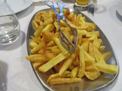 A family style platter of amazing home made fries.....piping hot and just the right amount of salt!!!