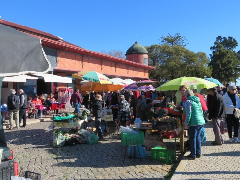 This is one tiny corner of the market. It stretches for about half a km or so all along the river and the market building property. Also both buildings, which are permanent markets, are full, one with fruits/vegetables/cheeses and butchers and the other fish fish and more fish!