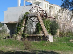 An old water wheel, long since abandoned.