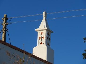 A happy heart themed chimney, lovingly painted.