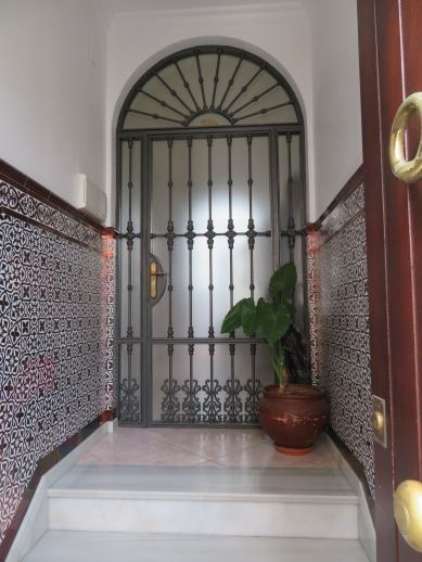I loved the reflection in the door and tiles in this open doorway to a private home