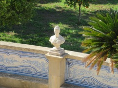 Love this bust in the garden......too bad my camera focused more on the palm leaf!!