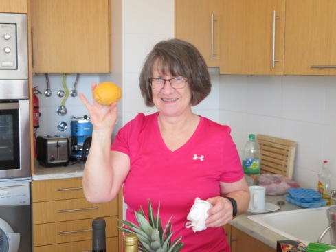 Carol appreciating the lemons we picked off our tree for her. That woman loves her gin and tonic!!