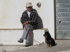Man and his best friend taking a break from their walk in the sunshine.