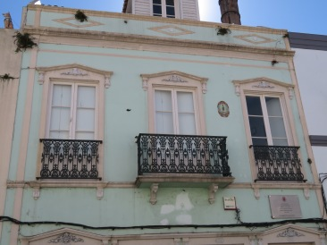 Lovely colour and balconies. The base of the balcony is solid volcanic rock.