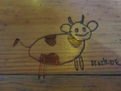 This was carved into our dining table at lunch. Cute.