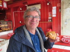 Marc enjoying a shredded sweet pumpkin filled croissant.