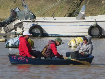 These three were giggling and laughing quite a bit as they crossed the harbour in this little boat. They didn't seem at all perturbed by the water lapping at the edges!!