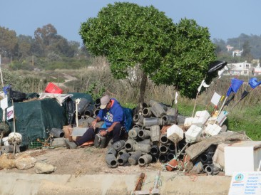 This man was diligently cleaning out his octopus pots. It's a tough life these fishermen lead.
