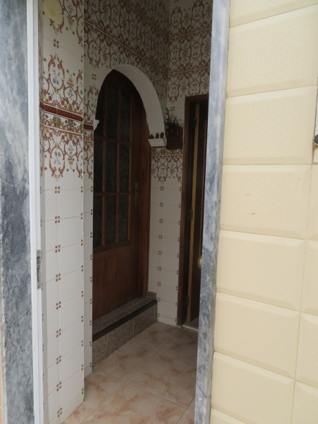This door was open and I could see the inner foyer. The tilework and the glass in the inner door was quite lovely.