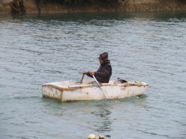 This fellow was rowing this tiny boat all the way out the harbour to the open water. He was none to happy that I took his photo!!!! Mea culpa!!