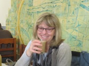 Laurie enjoying a taste of her first galão which is a hot drink from Portugal made of espresso and foamed milk.