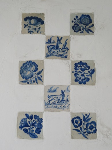 Hand painted tiles set into the wall in a private garden.