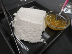 Fresh cheese with pumpkin sauce.
