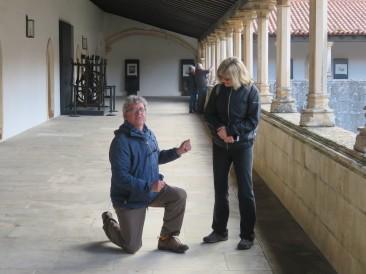 No, he is not proposing. He is tying up his shoe!
