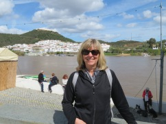 Laurie with Sanlucar de Guadiana, Spain in the background.