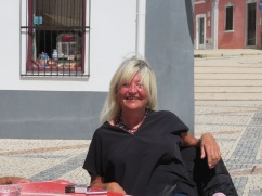The ever smiling Susie enjoying a relaxing time on the patio...........we love seeing her here.