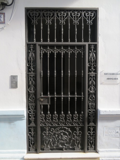 Love this style of door with the Moorish influences.