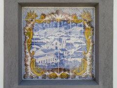 A series of lovely tiles depicting life in Alte, set in the wall along an old building.