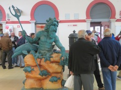I thought this was amusing....two new statues in the market.....this one, male, surrounded by men...see next photo.