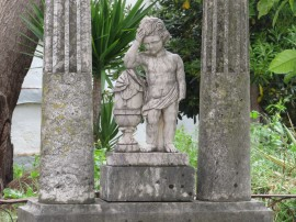 Part of a very old tomb in the side cemetery of the old church.