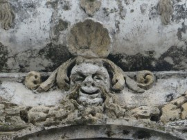 This carving, high atop the church, was probably quite detailed once upon a time. The winds and rains over the years, and probably the sun, have softened it and you have to look closely to appreciate the features.