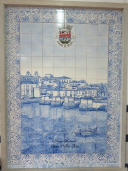 This lovely tile work is inside the train station. Depicts the old Roman Bridge.