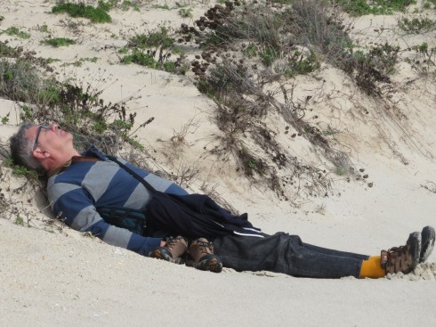 Laying in the dune enjoying the warmth of the sand and sun plus the sound of the surf.