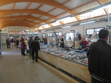 Inside the market building the fishermen are selling todays catch, which smells sweet and tempting to the tastebuds!