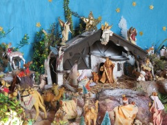 The local church was open and we popped in to see the nativity scene.......which was quite elaborate with running water etc.. The way the sun was shining in the door, I couldn't get a good shot so this is simply a part of it.