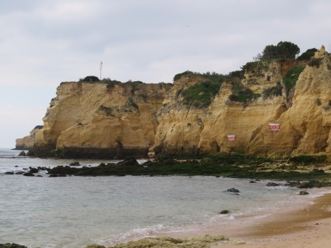 """Small caves dot the cliffs as well as the """"danger signs"""" for falling rocks."""