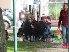 All the old men sit around and chat in the nearby park while the women shop.