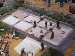 A replica of the salt flats and the folks collecting the salt.