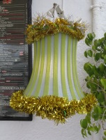 On the main street lamp shades had been decorated at the patio of a restaurant.