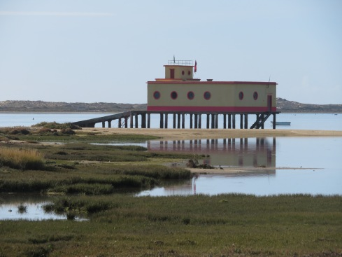 The low tide was well under way and the beach fairly quiet except for a few diehard fishermen,