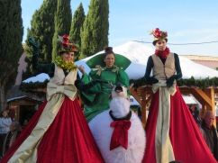 Stilt walkers. Very festive and willing to pose for one and all.