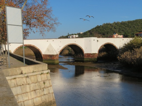 The old Roman Bridge over the Arade River, which is a tidal river. It was low tide.