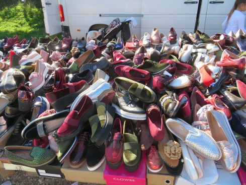 Tables piled high with shoes.......I could imagine trying to find two the same size!!