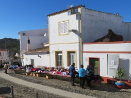 A tiny local market had set up and the women of the town were scurrying to see what the purchases of the day might be.