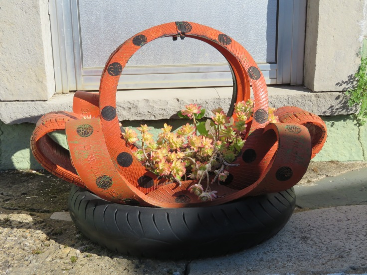 I loved that they used two old tires, one painted, to create this succulent holder.