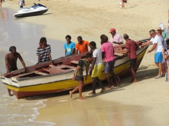 A lively activity....involving locals and tourists....they pushed the boat from where it had rested during low tide on the beach, all the way to and in the water.
