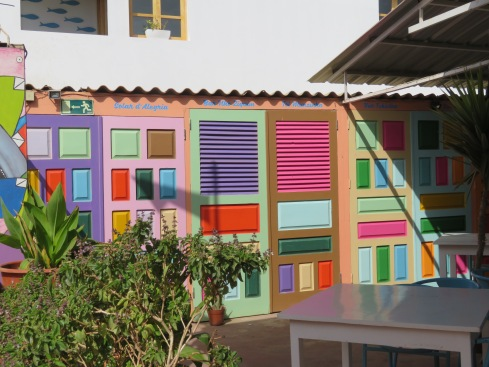I thought this idea of using all these colourfully painted doors as a wall on the patio was quite clever.