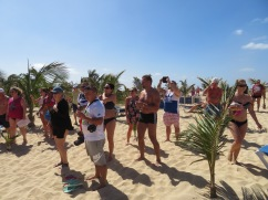 Revelers on the beach, hands clapping, hips swaying and lots of energy and fun.