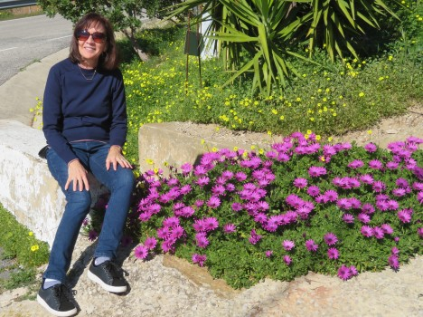 Diane basking in the warmth of the sunshine and delighting in the flowers.