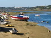 At the end of the beach is the fishermen village. Still active and busy. With it being low tide the boats were resting more in the shoreline than bobbing on the waves.